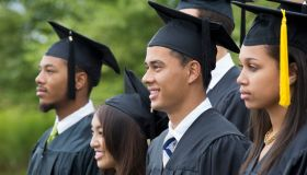 Graduates posing together outdoors