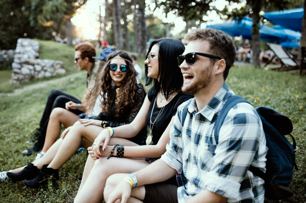 A singing group of people impatiently waiting for music festival to start. Friendship concept. depth of view