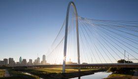 USA, Texas, Dallas, Margaret Hunt Hill Bridge and skyline at sunrise