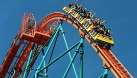 Roller coaster riders throw their hands in the air as they ride 'Goliath,' the newest roller coaster