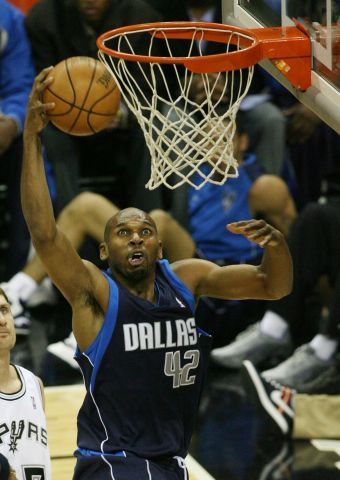 The Dallas Mavericks' Jerry Stackhouse goes up for a baskets
