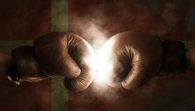 Cropped Image Of Boxers Fighting Against Illuminated Danish Flag