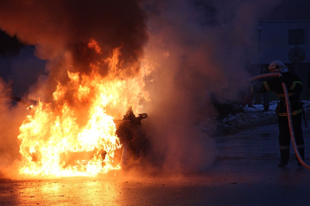 Bulgarian firefighters work hard to put out a massive fire from a burning car