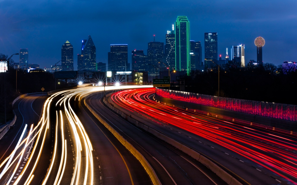 DALLAS SKYLINE and Tom Landry Freeway, with streaked lights