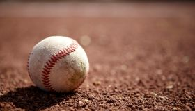 Still life of a baseball on baseball diamond