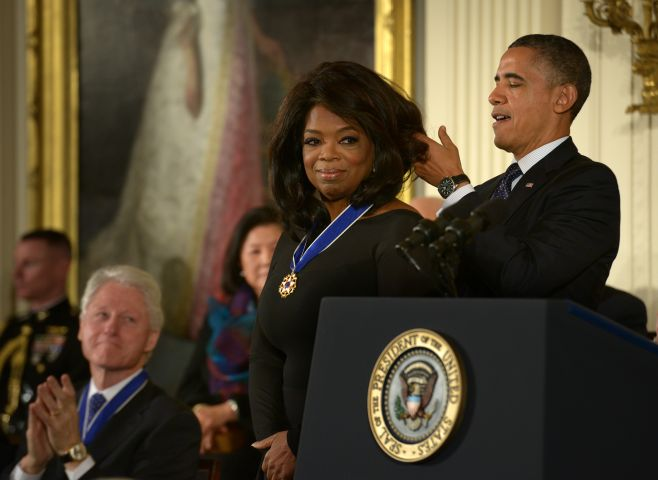 President Barack Obama awards the Presidential Medal of Freedom to Ben Bradlee, among others, in Washington, DC.
