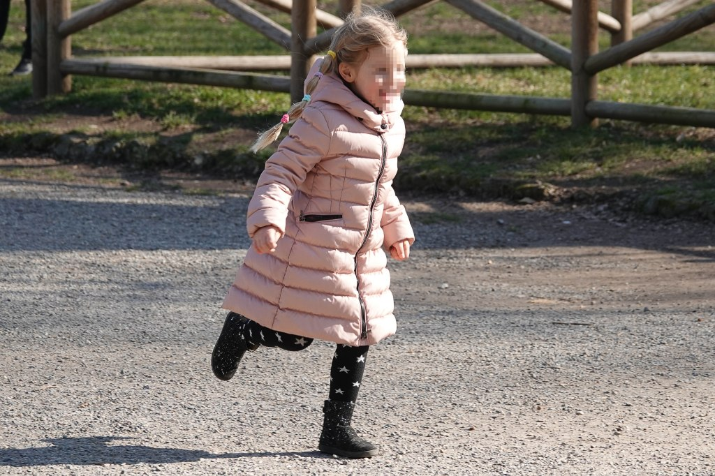 Michelle Hunziker takes her daughters and dogs to the park