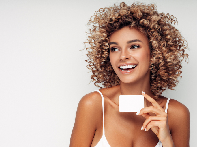Beautiful woman with business card