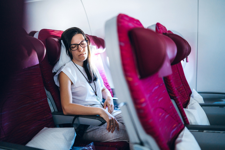 Female passenger sleeping in airplane