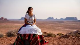 Portrait of a Beautiful Young Twelve Year Old Navajo Girl in Traditional Native American Clothing Posing in the Desert near the Monument Valley Tribal Park in Northern Arizona at Sunset or Sunrise